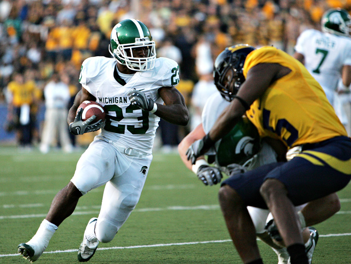 Michigan State running back Javon Ringer looks for a hole to make a quick break