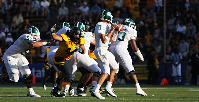 Defensive lineman Tyson Alualu goes after Michigan St. QB Brian Hoyer