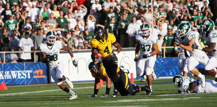 Jahvid Best turns up the afterburners as he eludes a pack of Michigan St. defenders