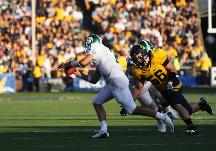 Zach Follet attempts to tackle Michigan St. quarterback Brian Hoyer through the shade