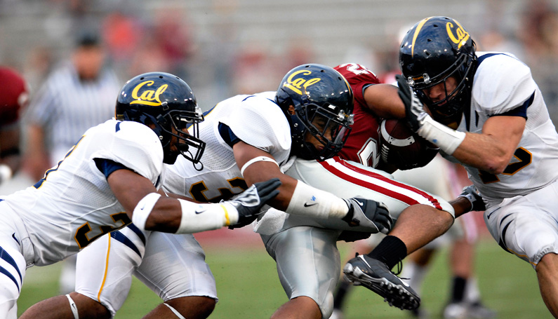 Nikon D200, 400mm: Cal defenders team up to bring down a Washington State player