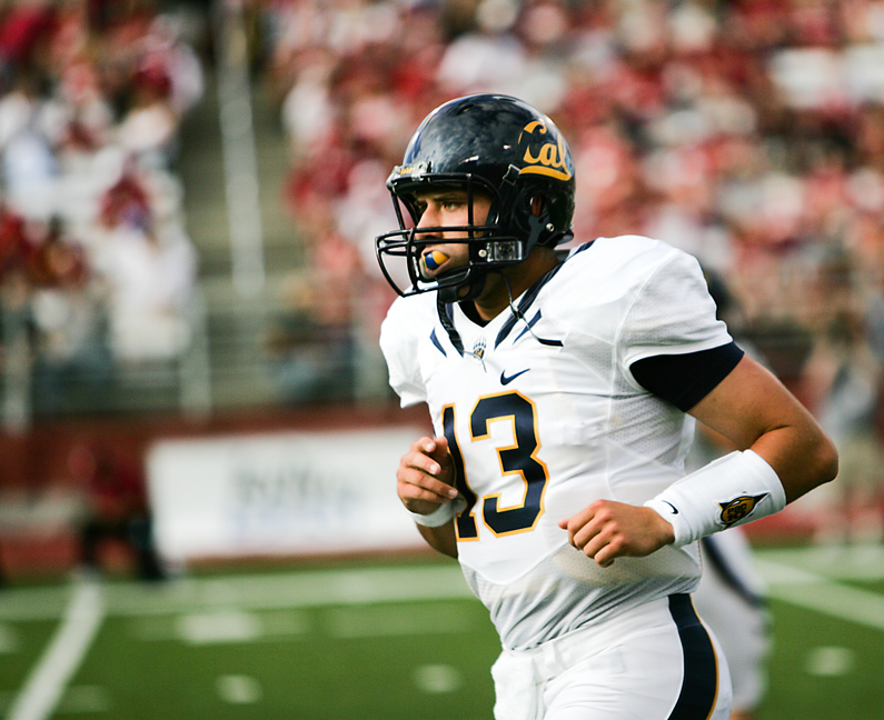 California quarterback Kevin Riley jogs back to the sideline