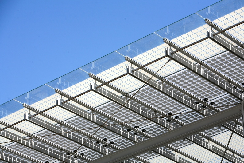 The Academy's awning has photovoltaic cells installed at the top to help power the building with solar energy
