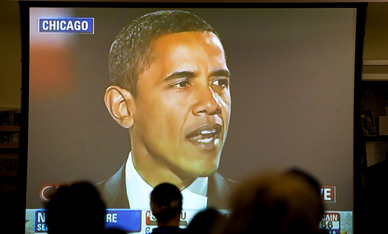 Members of the public watch a broadcast of Senator Barack Obama's victory speech at the IGS Library in Moses Hall